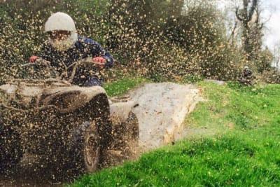 Gorcombe - Quad biker riding through mud