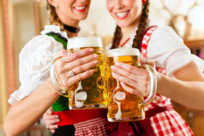 Two women drinking beers in a Bavarian beer house