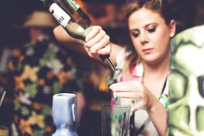 woman enjoying a cocktail making class