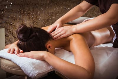 A woman receives a massage during a pampering session