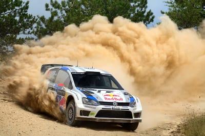 Rally car kicking up dust