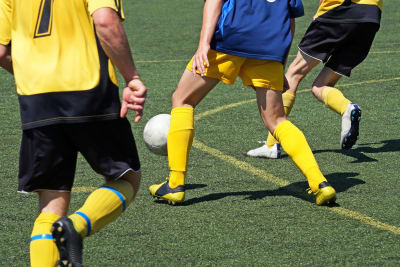 A group of stags playing Football