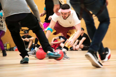 A man playing dodgeball