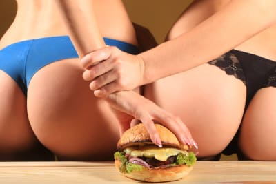 a pair of strippers and a burger