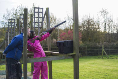 A woman on a hen party doing clay pigeon shooting activity