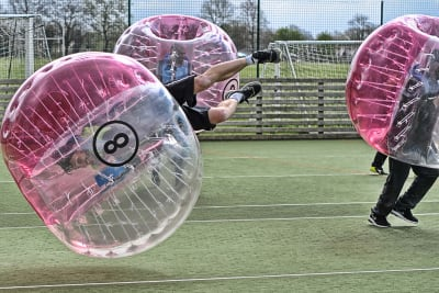 A laughing stag group play zorb footballl