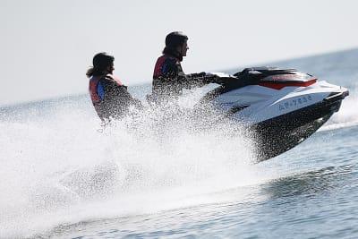Two women having fun on a jetski