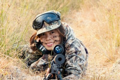 A hen playing airsoft