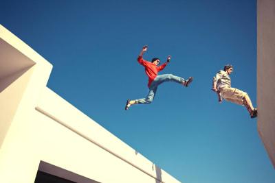 Stunt man activity jumping between buildings