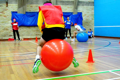 A man on a space hoper at a schools sports day