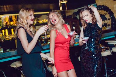 girl on clubs drinks having fun