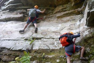 group of guys rock climbing