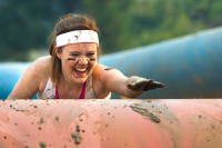 A woman having fun on an assault course