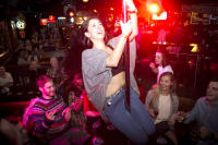 A woman dances on the bar during a bar crawl