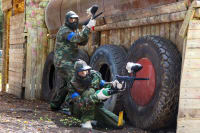 two men playing paintball