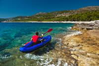 A man kayaking