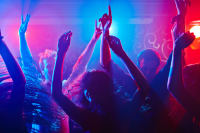 Group of people dancing in a club