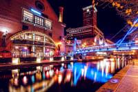 A busy brightly lit canal in Birmingham
