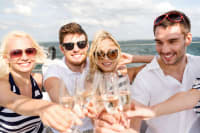 A group of people having fun on a boat party