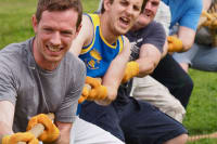 A group of men playing tug of war flipped image