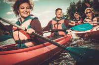 happy friends enjoying kayaking on river two seat kayak