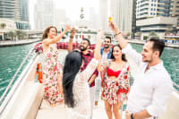 friends enjoying drinks and private yatch in Dubai