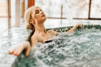 woman in spa enjoying pool