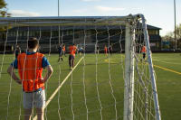 Five-A-Side Football group of guys playing football focus on gatekeeper