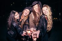 group of women drinking champagne in nightclub VIP aspect