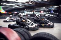Go karts racing around a track flip image