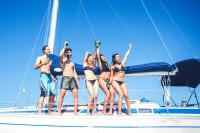 Friends on catamaran boat in summmer