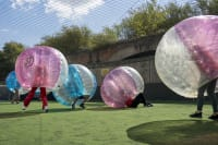 outdoor zorb football image mixed group extreme event logo removed