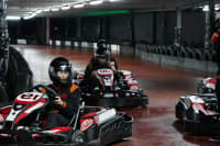 mixed group doing indoor go karting chilli