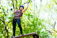A woman having fun on a high ropes course