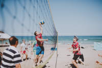 GROUP OF MANS PLAYING VOLLEYBALL