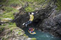 A guy doing coasteering