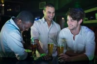 Group of Men Partying with glass of Beer at the Bar