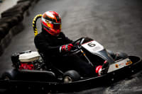 A group of people racing go karts around a track