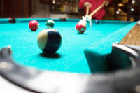 A group of people playing pool
