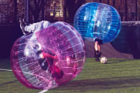 A stag croup are playing zorb football