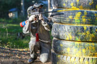 A group of people enjoying a game of paintball