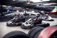 Go karts racing around a track
