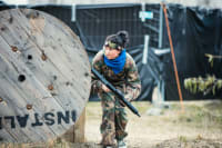 A woman playing airsoft