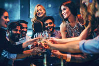 Group of friends laughing and clinking champagne glasses -  VIP tables