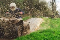 Gorcombe - Quad biker riding through mud