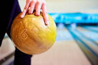 A person holding a bowling ball