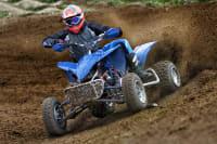 Quad bike racing through mud