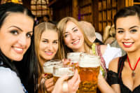 A group of attractive women in a Bavarian beer house