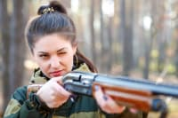 A woman shooting during clay pigeon shoot