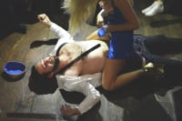 A man is sat on by a stripper during a stag arrest